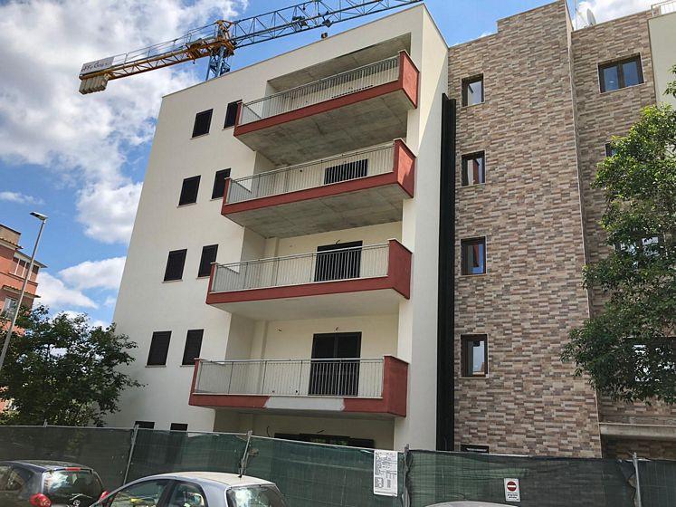 Costruzione palazzina residenziale nel quartiere Portuense a Roma.
